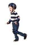 Chłopiec w ochrona hełmie w niepokojach i kolana i ręki Zdjęcia Royalty Free