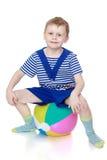 Chłopiec w paskował ubrania zdjęcia royalty free