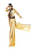 Chłopiec w złocistym bieg na stilts Zdjęcia Royalty Free