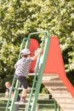 Chłopiec wspina się obruszenie drabinę Fotografia Stock
