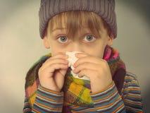 Chłopiec wyciera jego nos Fotografia Stock