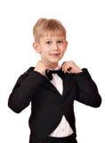 Chłopiec z łęku krawatem i czarny smokingiem Fotografia Royalty Free