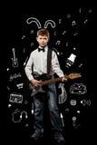 Chłopiec z gitarą Fotografia Stock