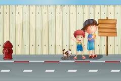 Chłopiec z ich zwierzętami domowymi w ulicie Zdjęcie Royalty Free