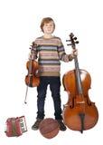 Chłopiec z instrumentami muzycznymi i koszykówką Zdjęcie Royalty Free