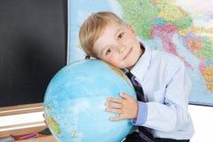 Chłopiec z kulą ziemską Obraz Royalty Free
