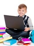 Chłopiec z laptopem i książkami Obraz Royalty Free