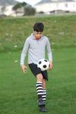 Chłopiec z piłki nożnej piłką outside Zdjęcie Stock