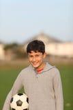 Chłopiec z piłki nożnej piłką outside Zdjęcia Royalty Free