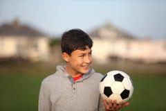 Chłopiec z piłki nożnej piłką outside Obrazy Royalty Free