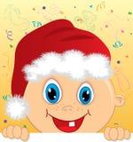 Chłopiec z Santa kapeluszowy osiągać szczyt Obrazy Stock