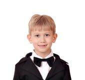 Chłopiec z smokingiem i łęku krawatem Zdjęcia Stock