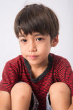 Chłopiec z smucenie twarzą i oko portretem Obrazy Royalty Free