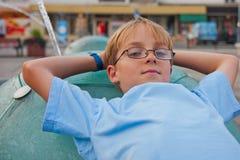 Chłopiec z szkłami Fotografia Royalty Free