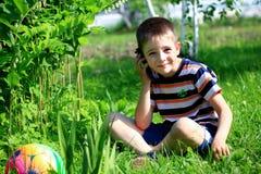 Chłopiec z Telefon Komórkowy Obraz Royalty Free