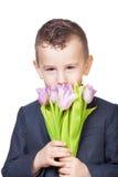 Chłopiec z tulipanami obraz royalty free