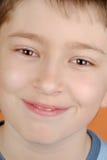 chłopiec zamknięty sprostać Fotografia Royalty Free