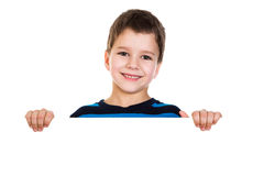Chłopiec zerknięcie out od białego sztandaru Obrazy Royalty Free