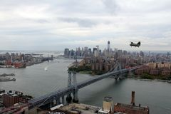CH-46E Manhattan. This photo was taken in 2012. A CH-46E flying with Manhattan in the background. Photo Includes World Trade Tower Six, Brooklyn Bridge, Statue stock photos