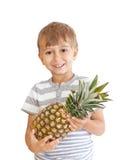 chłopiec ananas Zdjęcia Stock