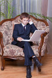 chłopiec biznesowy komórki komputer ufny Obrazy Royalty Free