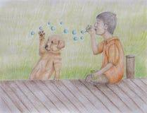 Chłopiec dmuchanie gulgocze dla jego szczeniaka Zdjęcie Stock