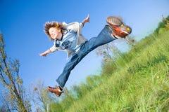 chłopiec doskakiwanie Fotografia Stock
