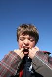 chłopiec dotyka jego usta Zdjęcie Royalty Free