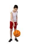 Chłopiec gracz koszykówki Zdjęcia Royalty Free
