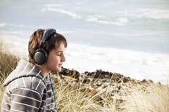 Chłopiec i ich muzyka Obrazy Royalty Free