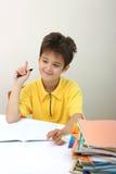 chłopiec jego praca domowa Zdjęcia Royalty Free