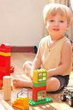 chłopiec jego zabawki Fotografia Royalty Free