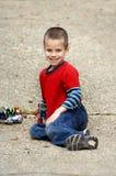 chłopiec jego zabawki Zdjęcie Royalty Free