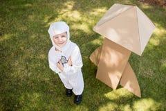 Chłopiec jest opatrunkowa up jako astronauta Obraz Stock