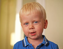 Chłopiec jest waggish Obrazy Royalty Free