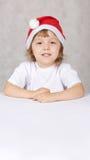 chłopiec kapelusz Santas Zdjęcie Royalty Free