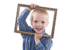 Chłopiec mienia rama Obraz Royalty Free