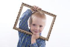 Chłopiec mienia rama Obraz Stock