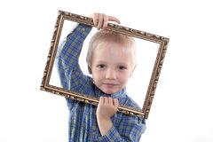 Chłopiec mienia rama Zdjęcia Stock
