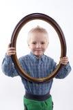 Chłopiec mienia rama Obrazy Stock