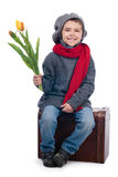 Chłopiec mienia tulipanu kwiaty Obraz Stock