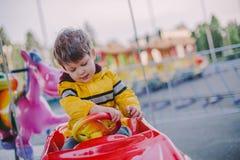 Chłopiec na karuzeli Zdjęcia Stock