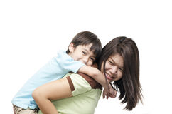 Chłopiec na matka plecy Zdjęcia Stock