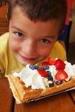 Chłopiec one waffle Zdjęcie Royalty Free