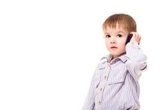 Chłopiec opowiada na telefonie obraz royalty free