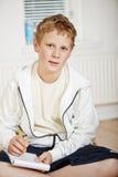 chłopiec robi nastoletniej jego pracie domowej Obrazy Royalty Free
