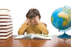 chłopiec robi pracie domowej Zdjęcia Stock