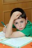 chłopiec robi pracie domowej Obraz Royalty Free