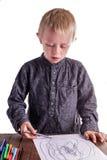 Chłopiec rysuje rysunek Obraz Stock
