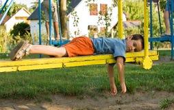 chłopiec seesaw Zdjęcie Royalty Free